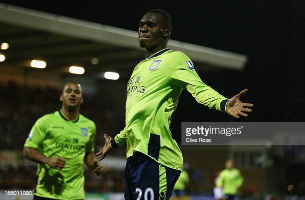 Christian Benteke of Aston Villa celebrates his winning goal during the Capital One Cup Fourth Round match between Swindon Town and Aston Villa at...