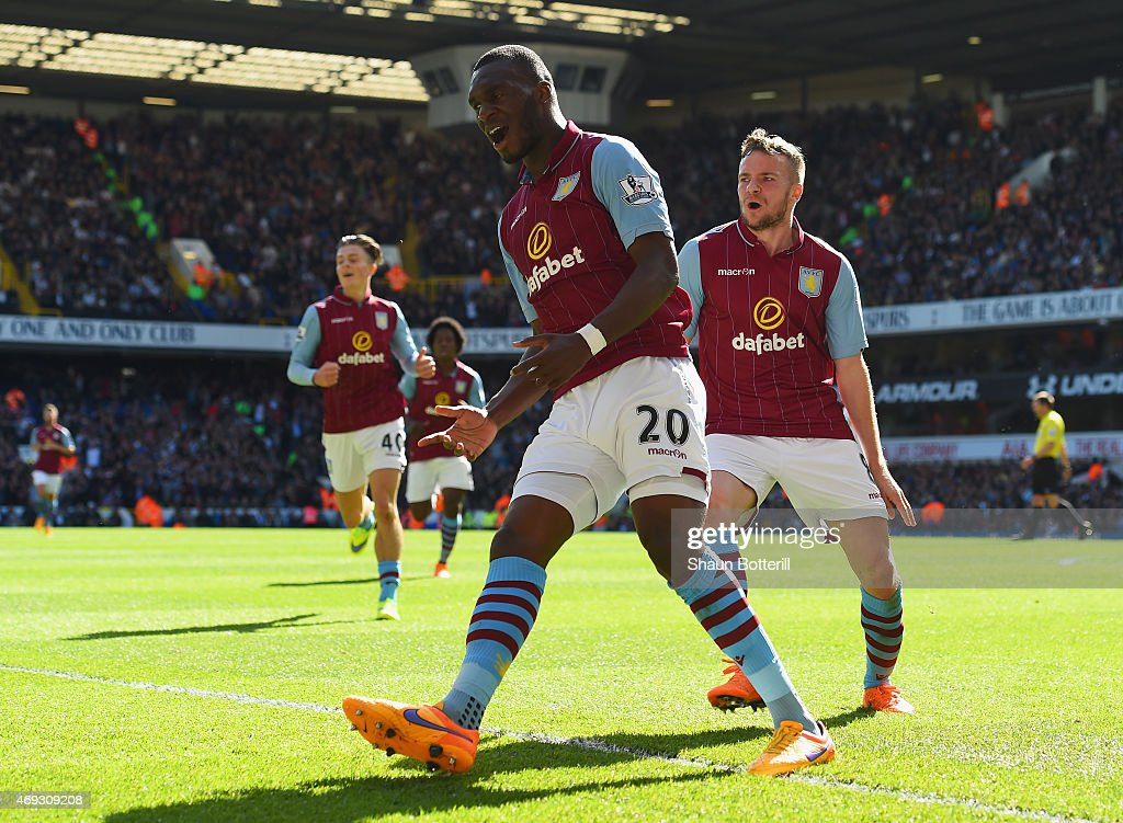 <a gi-track='captionPersonalityLinkClicked' href=/galleries/search?phrase=Christian+Benteke&family=editorial&specificpeople=4282509 ng-click='$event.stopPropagation()'>Christian Benteke</a> of Aston Villa celebrates scoring their first goal with <a gi-track='captionPersonalityLinkClicked' href=/galleries/search?phrase=Tom+Cleverley+-+Soccer+Player&family=editorial&specificpeople=4192565 ng-click='$event.stopPropagation()'>Tom Cleverley</a> of Aston Villa during the Barclays Premier League match between Tottenham Hotspur and Aston Villa at White Hart Lane on April 11, 2015 in London, England.