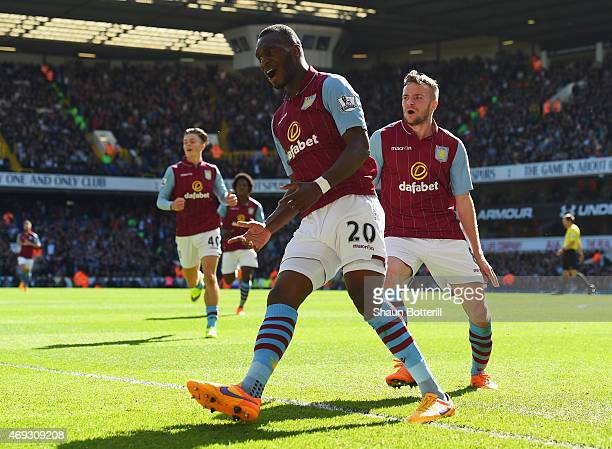 Christian Benteke of Aston Villa celebrates scoring their first goal with Tom Cleverley of Aston Villa during the Barclays Premier League match...