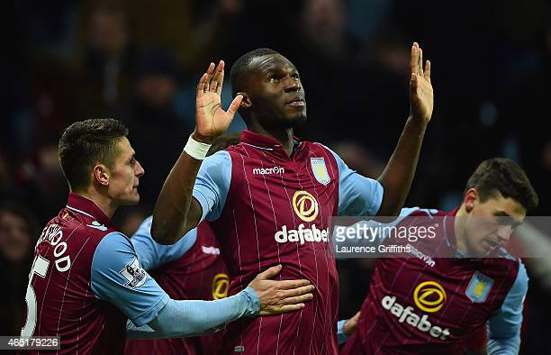 Christian Benteke of Aston Villa celebrates scoring their second goal from the penalty spot with team mates during the Barclays Premier League match...