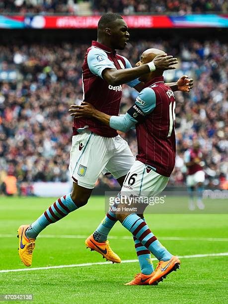 Christian Benteke of Aston Villa celebrates with Fabian Delph of Aston Villa after scoring the second goal during the FA Cup Semi Final between Aston...