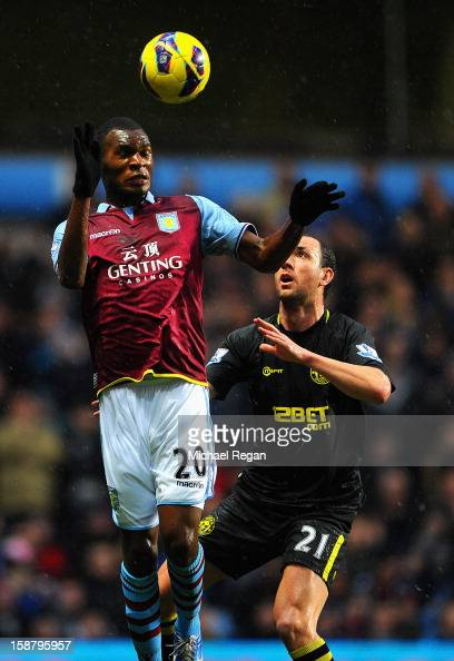Christian Benteke of Aston Villa in action with Ivan Ramis of Wigan during the Barclays Premier League match between Aston Villa and Wigan Athletic...