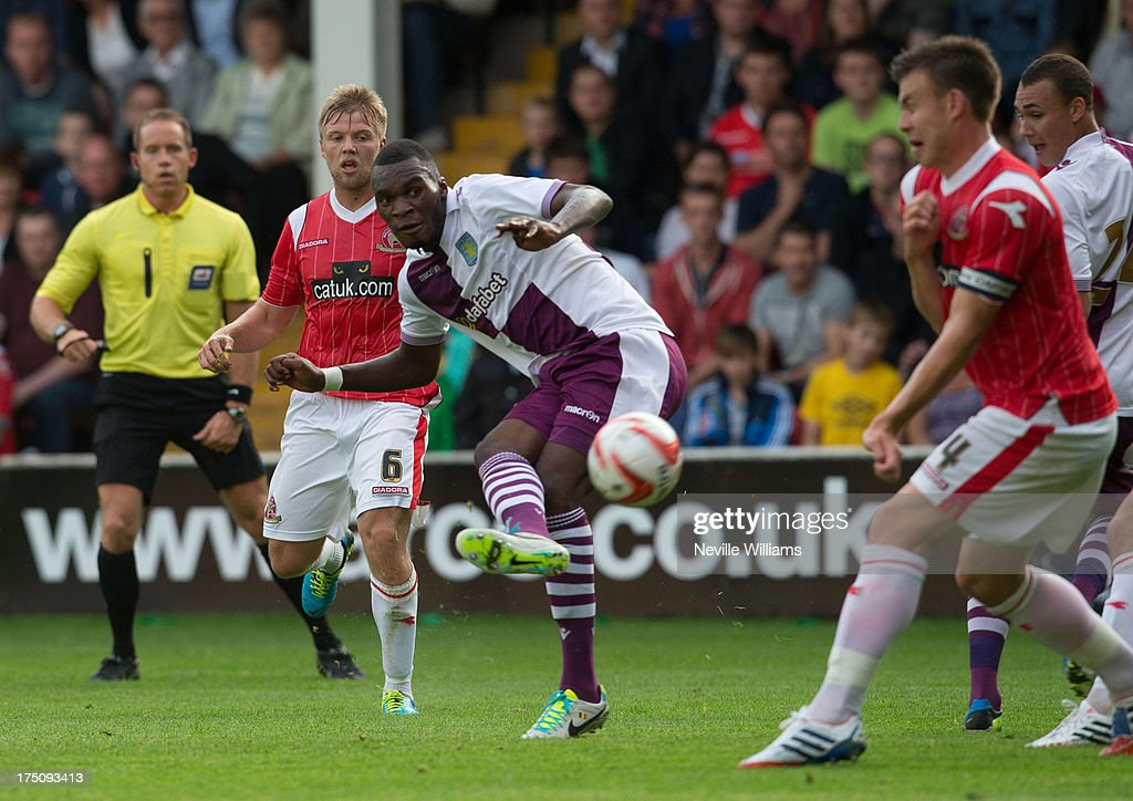 <a gi-track='captionPersonalityLinkClicked' href=/galleries/search?phrase=Christian+Benteke&family=editorial&specificpeople=4282509 ng-click='$event.stopPropagation()'>Christian Benteke</a> of Aston Villa is challenged by Andy Butler of Walsall during the Pre Season Friendly match between Walsall and Aston Villa at Banks' Stadium on July 31, 2013 in Walsall, England.