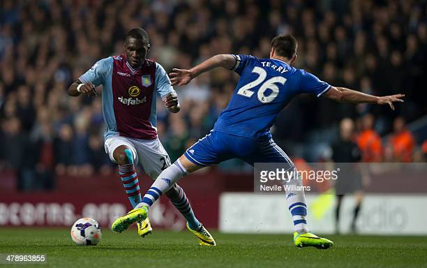 Christian Benteke of Aston Villa is challenged by John Terry of Chelsea during the Barclays Premier League match between Aston Villa and Chelsea at...