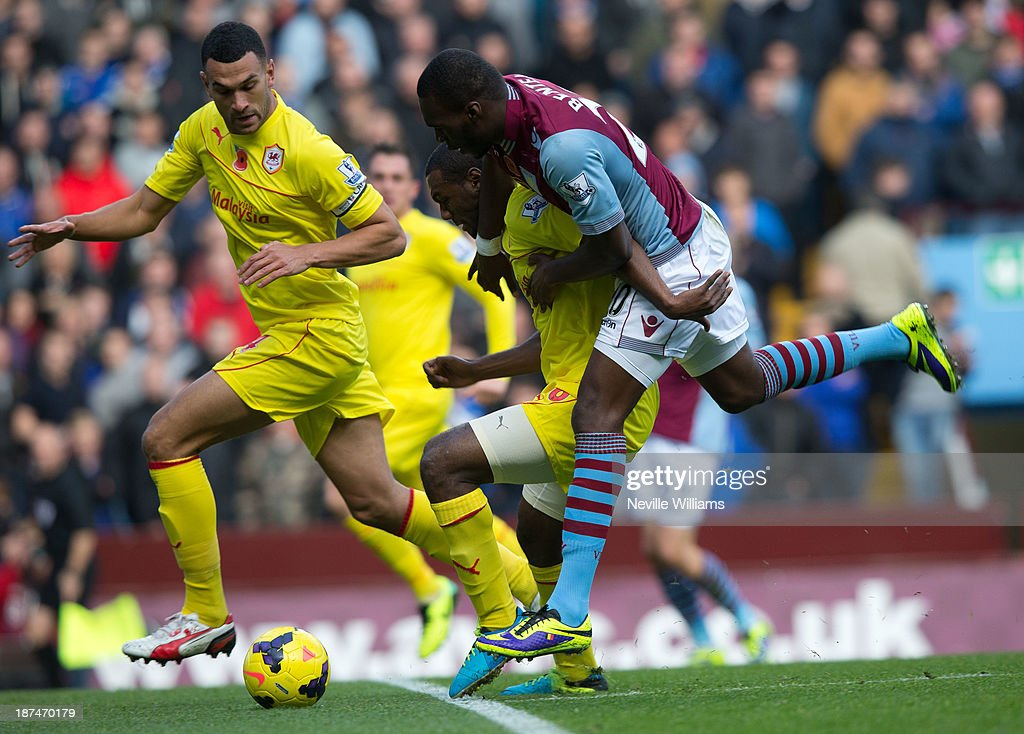 Christian Benteke of Aston Villa is challenged by Kevin Theophile-Catherine of Cardiff City during the Barclays Premier League match between Aston Villa and Cardiff City at Villa Park on November 09, 2013 in Birmingham, England.