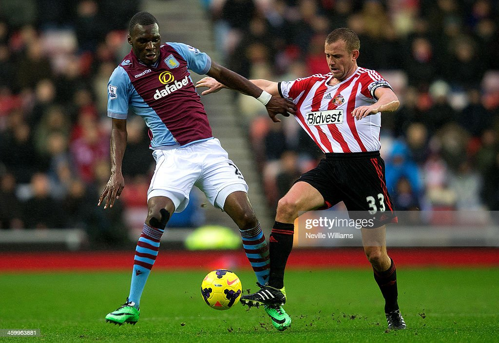 Christian Benteke of Aston Villa is challenged by Lee Cattermole of Sunderland during the Barclays Premier League match between Sunderland and Aston Villa at the Stadium of Light on January 01, 2014 in Sunderland, England.