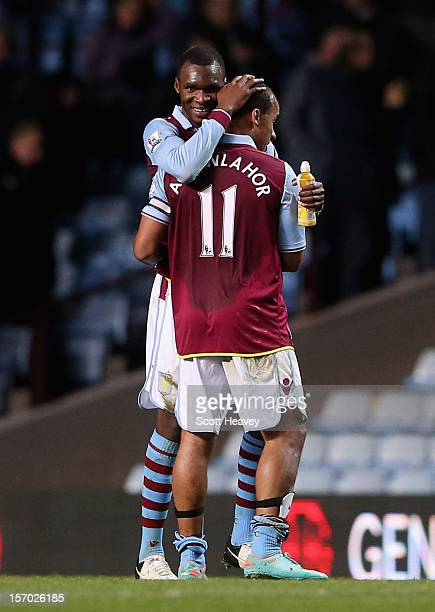 Christian Benteke of Aston Villa is congratulated by teammate Gabriel Agbonlahor at the end of the Barclays Premier league match between Aston Villa...