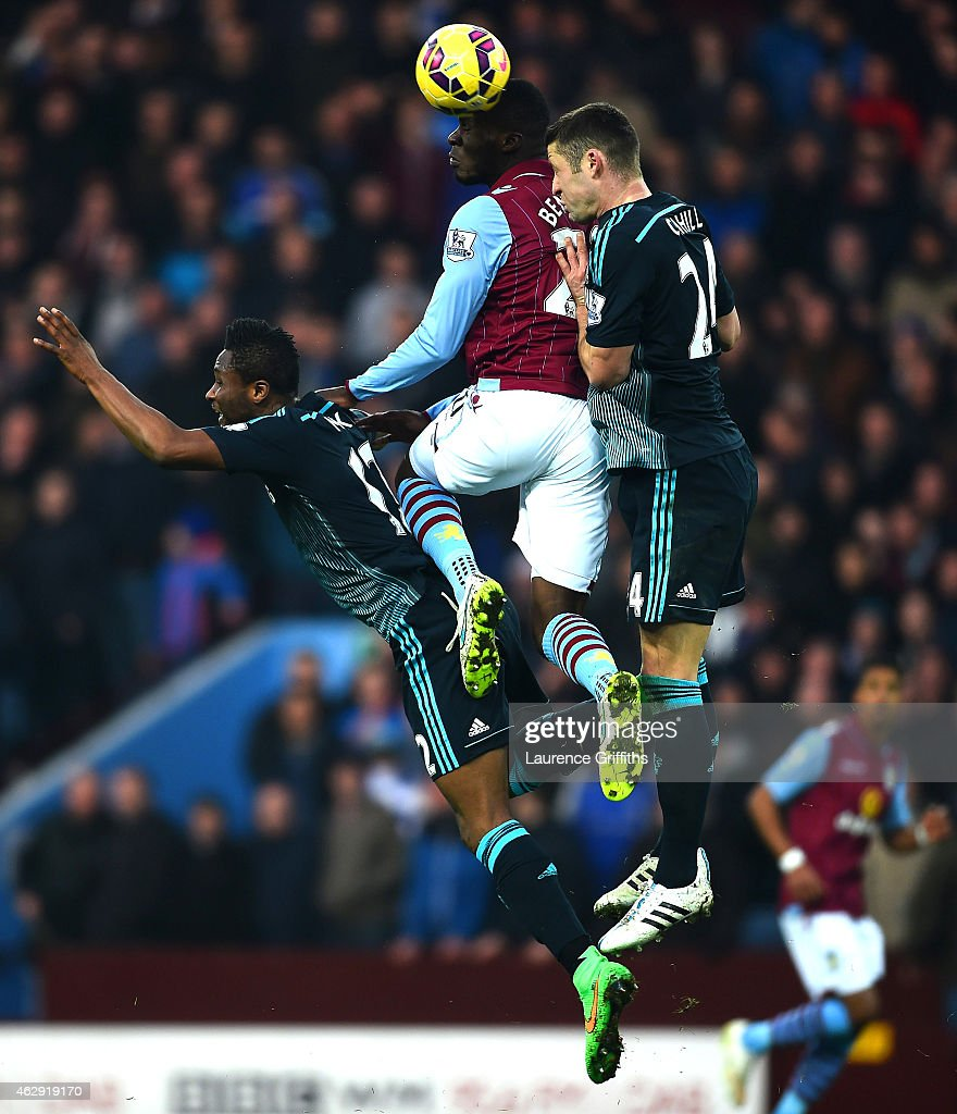 Christian Benteke of Aston Villa jumps for the ball with Mikel John Obi and Gary Cahill of Chelsea during the Barclays Premier League match between Aston Villa and Chelsea at Villa Park on February 7, 2015 in Birmingham, England.