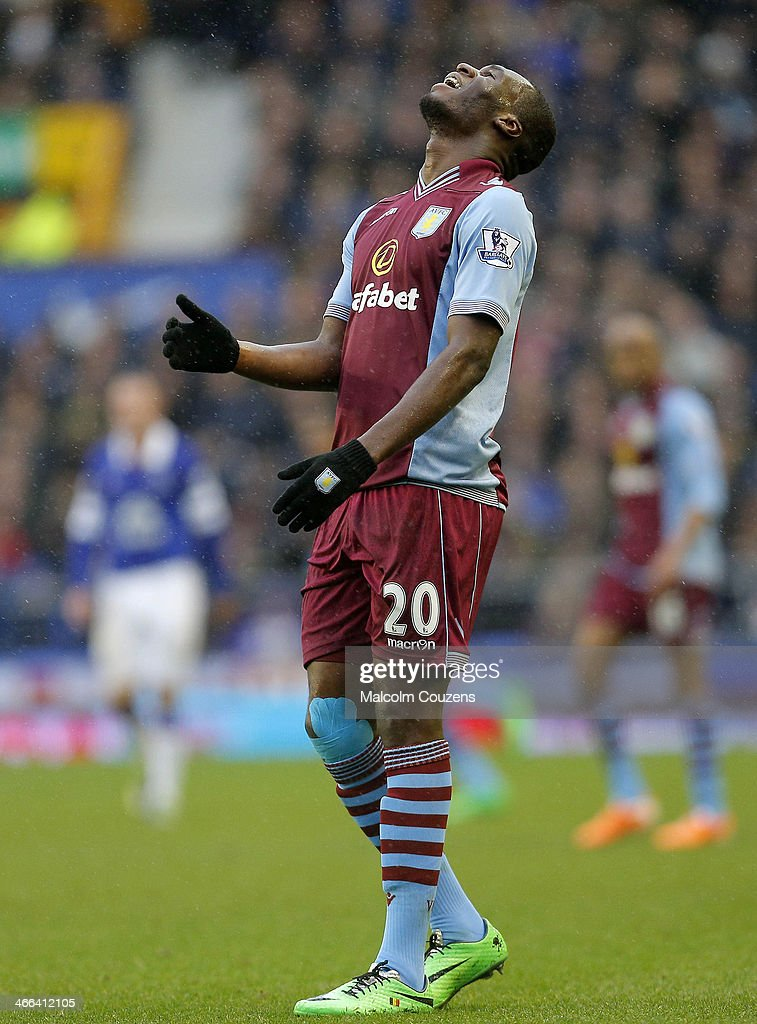 Christian Benteke of Aston Villa reacts duringthe Barclays Premier League match between Everton and Aston Villa at Goodison Park on February 1, 2014 in Liverpool England.