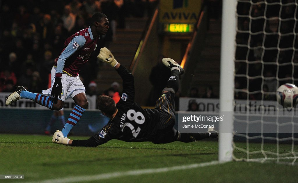 Christian Benteke of Aston Villa scoes a goal but is dissaloud as he was off side during the Capital One Cup Quarter-Final match between Norwich City and Aston Villa at Carrow Road on December 11, 2012 in Norwich, England.