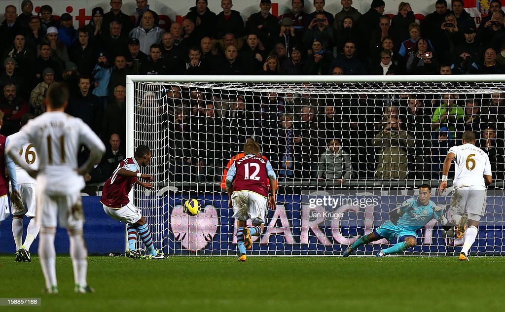 <a gi-track='captionPersonalityLinkClicked' href=/galleries/search?phrase=Christian+Benteke&family=editorial&specificpeople=4282509 ng-click='$event.stopPropagation()'>Christian Benteke</a> of Aston Villa (3rd L) scores from the penalty spot during the Barclays Premier League match between Swansea City and Aston Villa at the Liberty Stadium on January 1, 2013 in Swansea, Wales.