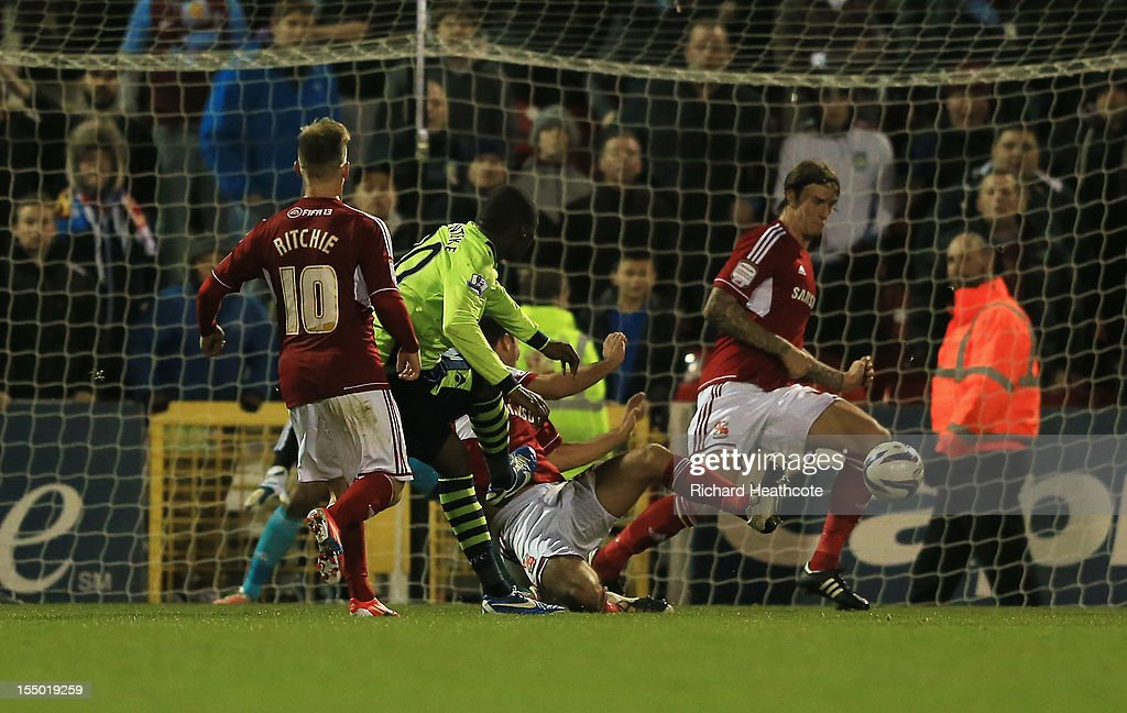 <a gi-track='captionPersonalityLinkClicked' href=/galleries/search?phrase=Christian+Benteke&family=editorial&specificpeople=4282509 ng-click='$event.stopPropagation()'>Christian Benteke</a> of Aston Villa scores his winning goal during the Capital One Cup Fourth Round match between Swindon Town and Aston Villa at the County Ground on October 30, 2012 in Swindon, England.