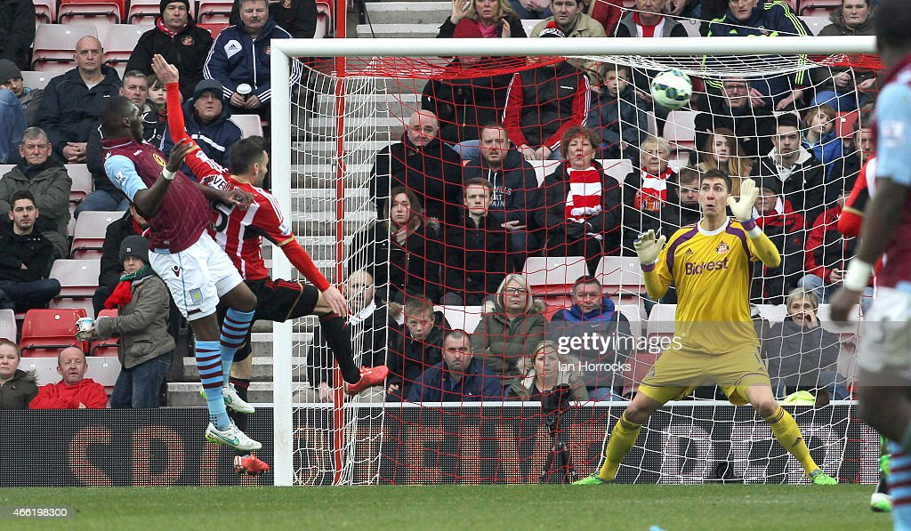 Christian Benteke of Aston Villa (L) scores the fourth goal during the Barclays Premier League match between Sunderland AFC and Aston Villa at The Stadium of Light on March 14, 2015 in Sunderland, England.