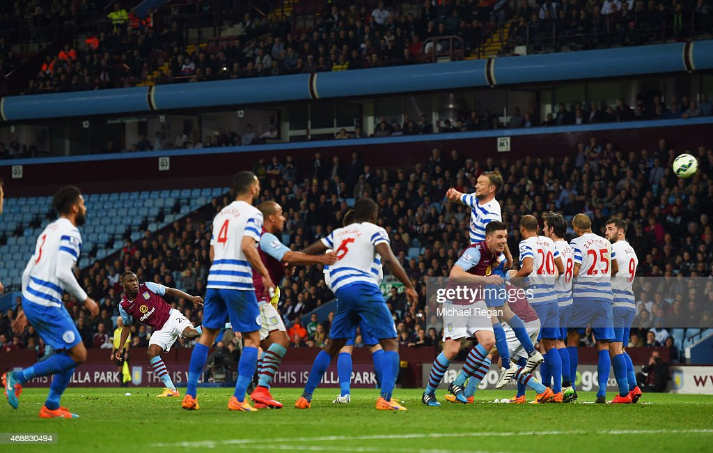 Christian Benteke of Aston Villa (2L) scores their third goal from a free kick and completes his hat trick during the Barclays Premier League match between Aston Villa and Queens Park Rangers at Villa Park on April 7, 2015 in Birmingham, England.