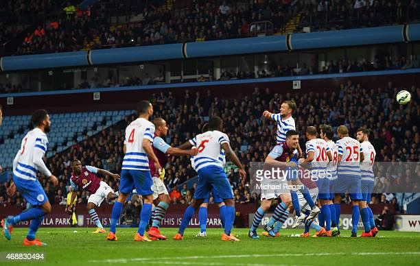 Christian Benteke of Aston Villa scores their third goal from a free kick and completes his hat trick during the Barclays Premier League match...