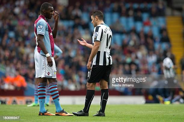 Christian Benteke of Aston Villa talks to Hatem Ben Arfa of Newcastle United during the Barclays Premier League match between Aston Villa and...