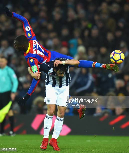 Christian Benteke of Crystal Palace and Claudio Yacob of West Bromwich Albion colide during the Premier League match between West Bromwich Albion and...