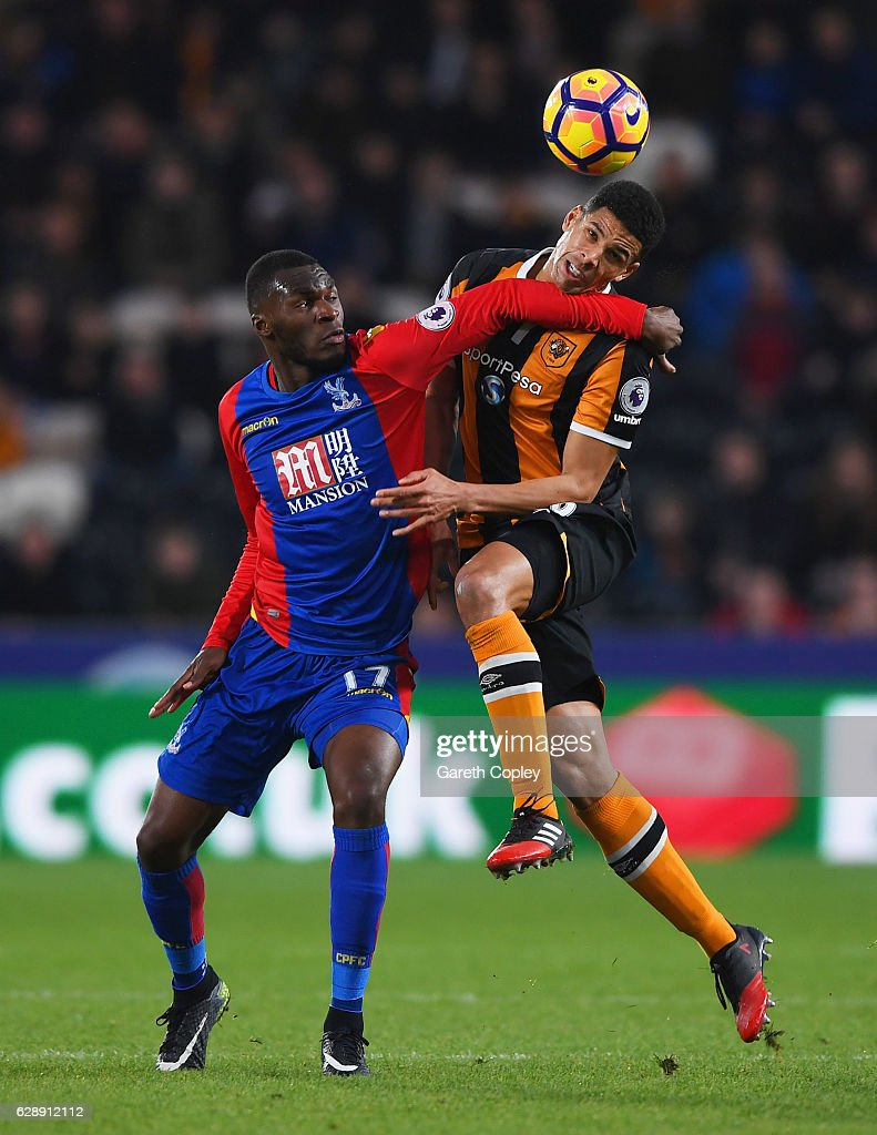 Christian Benteke of Crystal Palace and Curtis Davies of Hull City battle for the ball during the Premier League match between Hull City and Crystal Palace at KCOM Stadium on December 10, 2016 in Hull, England.