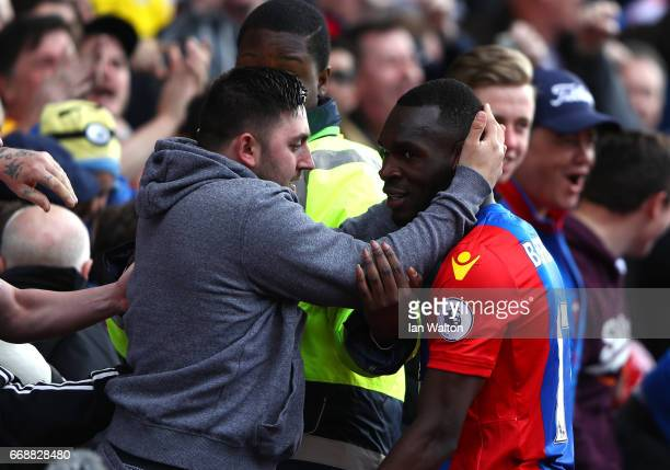 Christian Benteke of Crystal Palace celebrates scoring his sides second goal with a Crystal Palace fan during the Premier League match between...