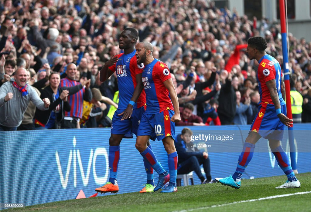 Christian Benteke of Crystal Palace celebrates scoring his sides second goal with Andros Townsend of Crystal Palace during the Premier League match between Crystal Palace and Leicester City at Selhurst Park on April 15, 2017 in London, England.
