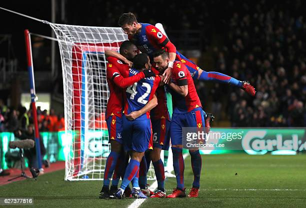 Christian Benteke of Crystal Palace celebrates scoring his team's third goal with his team mates during the Premier League match between Crystal...