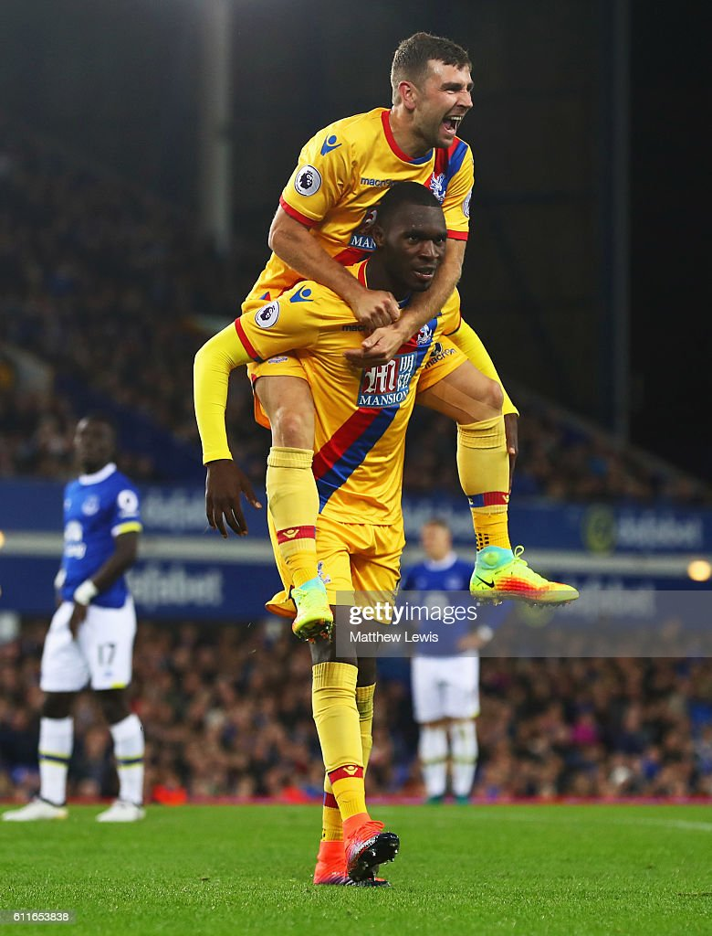 Christian Benteke of Crystal Palace celebrates with James McArthur as he scores their first goal during the Premier League match between Everton and Crystal Palace at Goodison Park on September 30, 2016 in Liverpool, England.