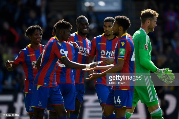Christian Benteke of Crystal Palace celebrates with team mates after equalising during a Pre Season Friendly between Crystal Palace and FC Schalke 04...