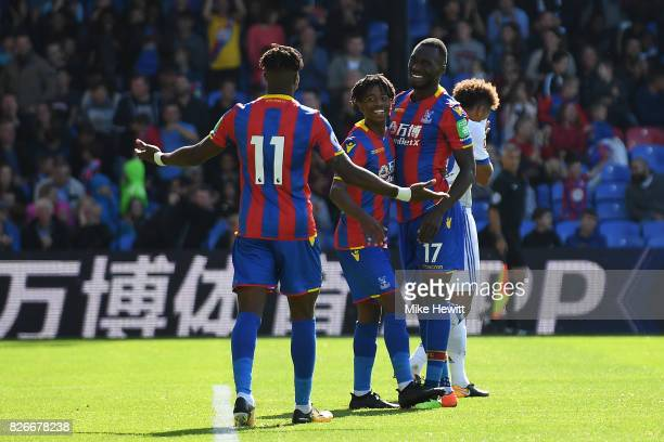 Christian Benteke of Crystal Palace celebrates with Wilfried Zaha and Jason Lokilo after equalising during a Pre Season Friendly between Crystal...