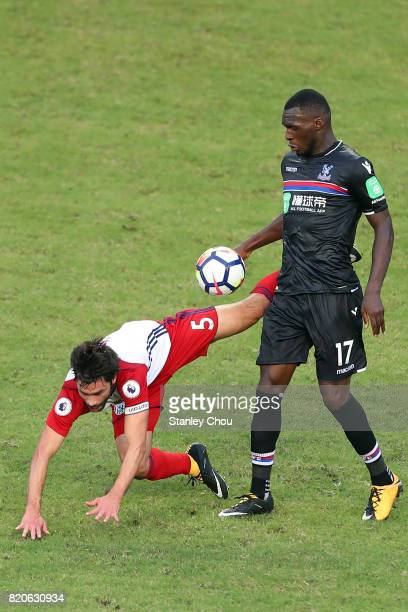 Christian Benteke of Crystal Palace clashes with Claudio Yacob of West Brombich Albion during the Premier League Asia Trophy match between West Brom...