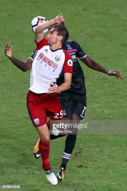 Christian Benteke of Crystal Palace clashes with Craig Dawson of West Brombich Albion during the Premier League Asia Trophy match between West Brom...