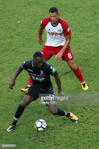 Christian Benteke of Crystal Palace evades Jake Livermore of West Brombich Albion during the Premier League Asia Trophy match between West Brom and...