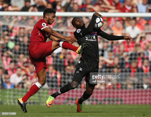 Christian Benteke of Crystal Palace handles the ball while under pressure from Joe Gomez of Liverpool during the Premier League match between...
