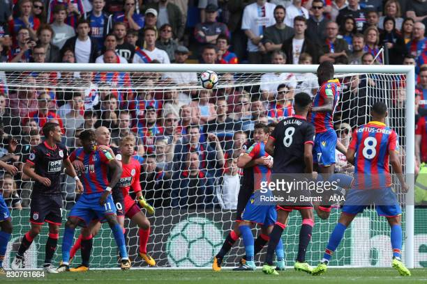 Christian Benteke of Crystal Palace has a header at goal during the Premier League match between Crystal Palace and Huddersfield Town at Selhurst...