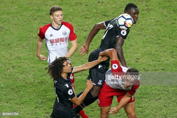 Christian Benteke of Crystal Palace heads clear during the Premier League Asia Trophy match between West Brom and Crystal Palace at Hong Kong Stadium...
