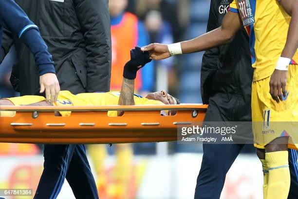 Christian Benteke of Crystal Palace holds the hand of Patrick Van Aanholt of Crystal Palace as he is stretchered off during the Premier League match...