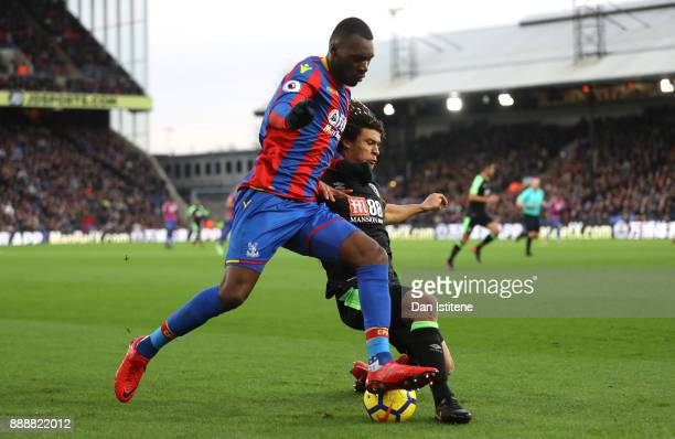 Christian Benteke of Crystal Palace is challenged by Nathan Ake of AFC Bournemouth during the Premier League match between Crystal Palace and AFC...