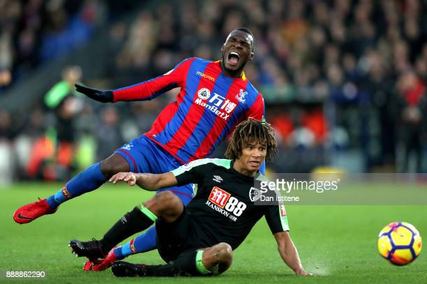 Christian Benteke of Crystal Palace is fouled by Nathan Ake of AFC Bournemouth during the Premier League match between Crystal Palace and AFC...