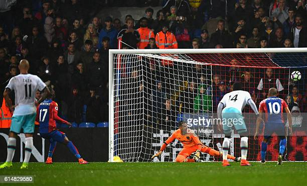 Christian Benteke of Crystal Palace misses from the penalty spot during the Premier League match between Crystal Palace and West Ham United at...