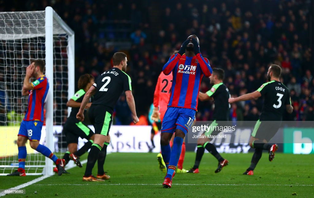 Christian Benteke of Crystal Palace reacts to missing a penalty during the Premier League match between Crystal Palace and AFC Bournemouth at Selhurst Park on December 9, 2017 in London, England.