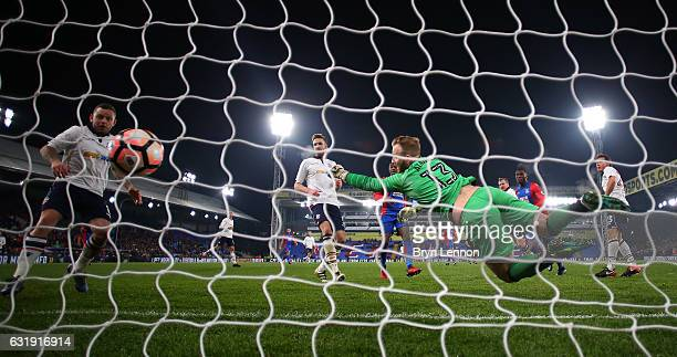 Christian Benteke of Crystal Palace scores his sides first goal past Ben Alnwick of Bolton during the Emirates FA Cup third round replay between...