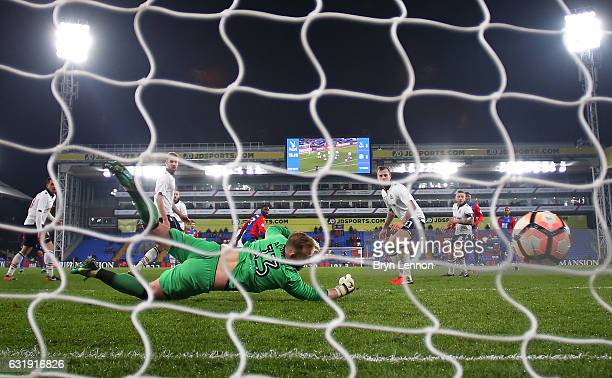 Christian Benteke of Crystal Palace scores his sides second goal during the Emirates FA Cup third round replay between Crystal Palace and Bolton...