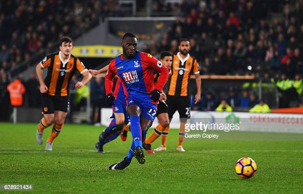 Christian Benteke of Crystal Palace scores their first and equalising goal from a penalty during the Premier League match between Hull City and...