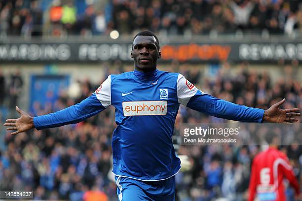 Christian Benteke of Genk celebrates scoring the second goal of the game during the Jupiler League match between KRC Genk and KAA Gent at the Cristal...