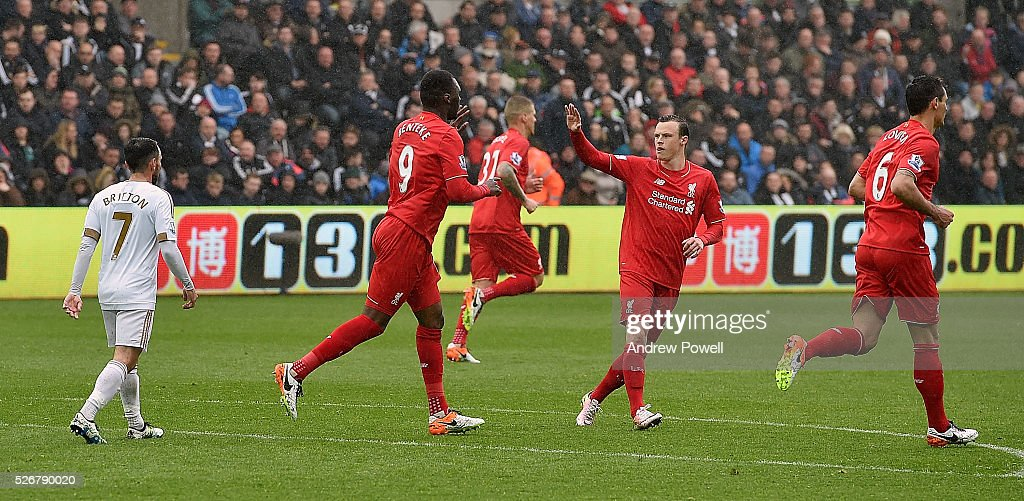<a gi-track='captionPersonalityLinkClicked' href=/galleries/search?phrase=Christian+Benteke&family=editorial&specificpeople=4282509 ng-click='$event.stopPropagation()'>Christian Benteke</a> of Liveprool celebrates after heading in a goal during a Premier League match between Swansea City and Liverpool at the Liberty Stadium on May 01, 2016 in Swansea, Wales.