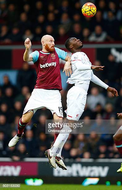 Christian Benteke of Liverpool and James Collins of West Ham United compete for the ball during the Barclays Premier League match between West Ham...