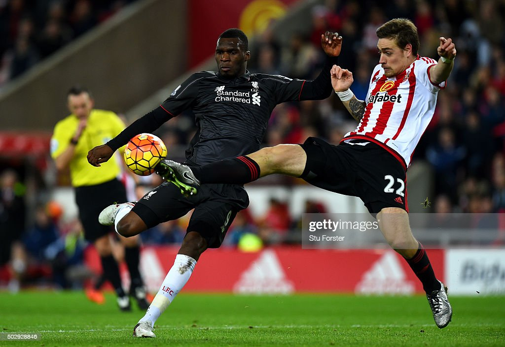 <a gi-track='captionPersonalityLinkClicked' href=/galleries/search?phrase=Christian+Benteke&family=editorial&specificpeople=4282509 ng-click='$event.stopPropagation()'>Christian Benteke</a> of Liverpool attempts to shoot at goal under pressure from <a gi-track='captionPersonalityLinkClicked' href=/galleries/search?phrase=Sebastian+Coates&family=editorial&specificpeople=5678488 ng-click='$event.stopPropagation()'>Sebastian Coates</a> of Sunderland during the Barclays Premier League match between Sunderland and Liverpool at Stadium of Light on December 30, 2015 in Sunderland, England.