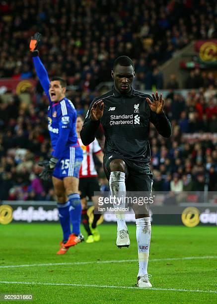 Christian Benteke of Liverpool celebrates after scoring the opening goal as Vito Mannone of Sunderland appeals for offside during the Barclays...