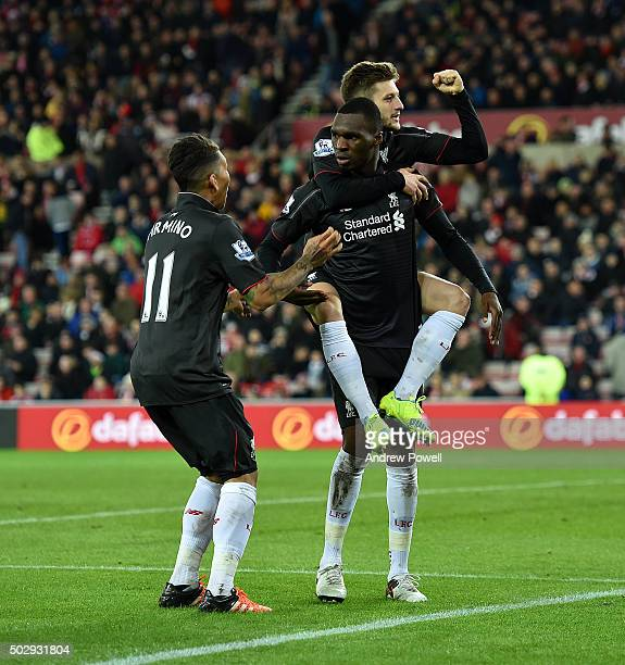 Christian Benteke of Liverpool celebrates after scoring the opening goal during the Barclays Premier League match between Sunderland and Liverpool at...