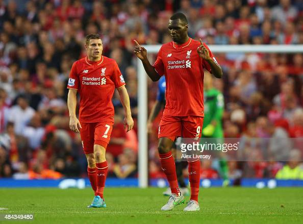 Christian Benteke of Liverpool celebrates alongside James Milner as he scores their first goal during the Barclays Premier League match between...