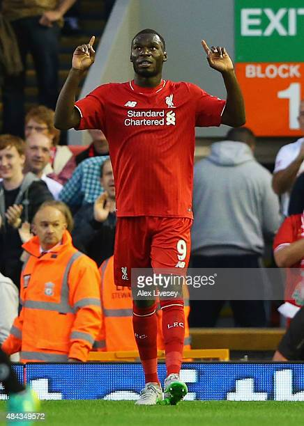 Christian Benteke of Liverpool celebrates as he scores their first goal during the Barclays Premier League match between Liverpool and AFC...